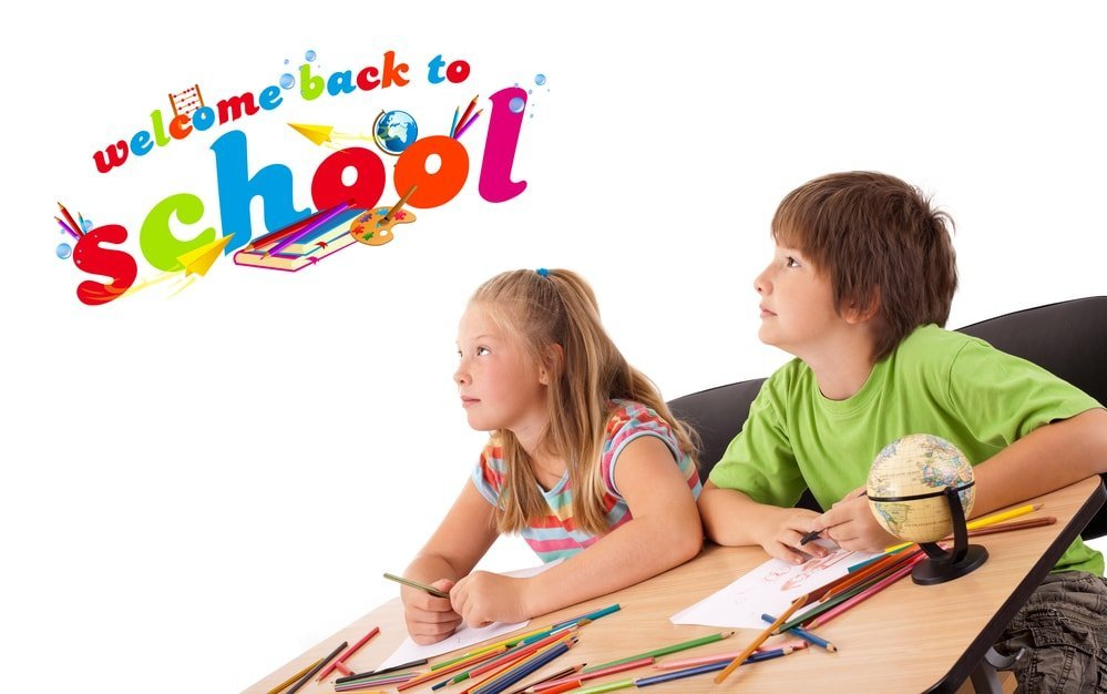 two kids with welcom back to school above them