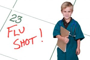 A child showing a calendar reminder for a Flu Shot