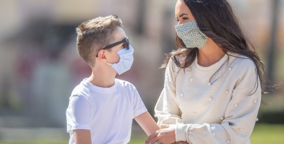 Mother And Son Wearing Masks