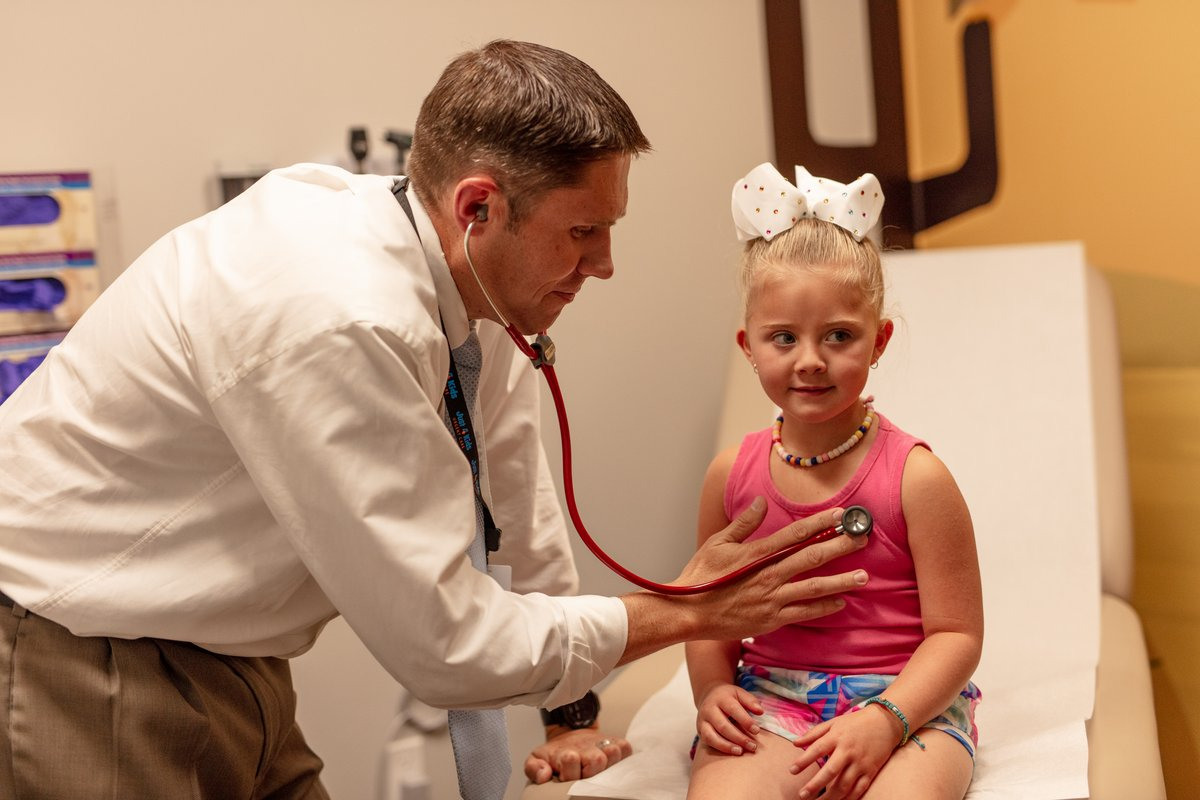 doctor exams girl in urgent care